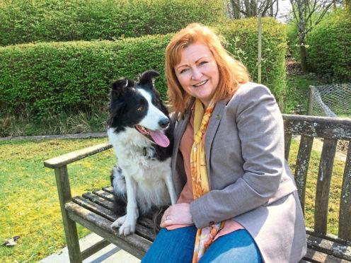 SNP's Emma Harper and her dog Maya.