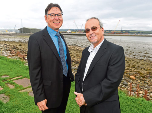 Bob Buskie, Chief Executive of the Cromarty Firth Port Authority and Roy MacGregor, Chairman of Global Energy. Picture by Sandy McCook