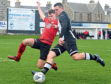 Scott Barbour takes on the defence. Picture by Jim Irvine