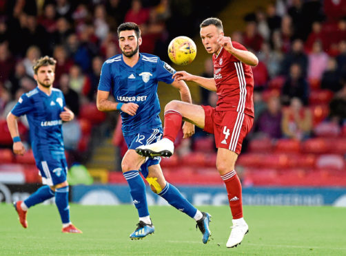 Chikhura Sachkhere's Mikheil Ergemlidze (centre) and Aberdeen's Andrew Considine battle for the ball during the UEFA Europa League second qualifying round second leg at Pittodrie Stadium, Aberdeen.
