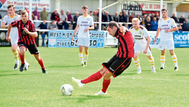Neil Gauld taking a penalty.  Picture by Jim Irvine