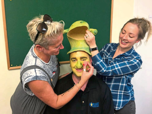 Make-up artists Sam Whitby and Madeleine Hewitt get to work on Liam MacAskill who stars as Shrek