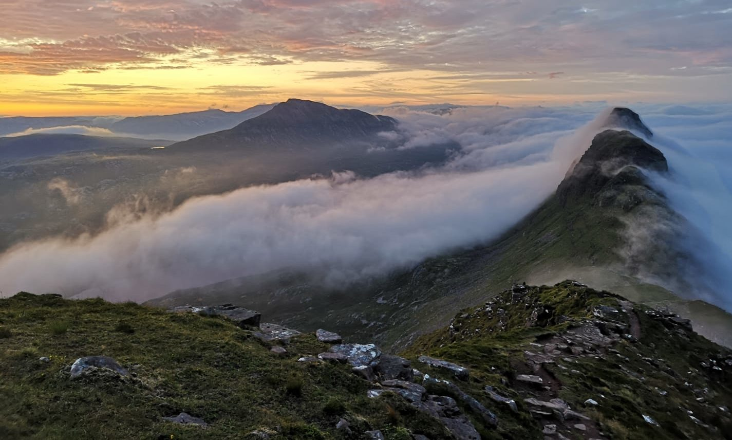 The sun rises on top of the Suilven Mountain.