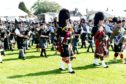 Mass Pipe Bands at the Aboyne Highland Games 2019 Picture by COLIN RENNIE