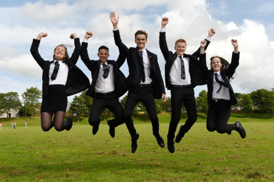Pupils from Westhill Academy, Aberdeenshire, received their exam results. Picture of (L-R) Emma Coull, Jamie Watt, Kieran Pirie, Matthew Mills, Caitlin Watt.  Picture by KENNY ELRICK 06/08/2019