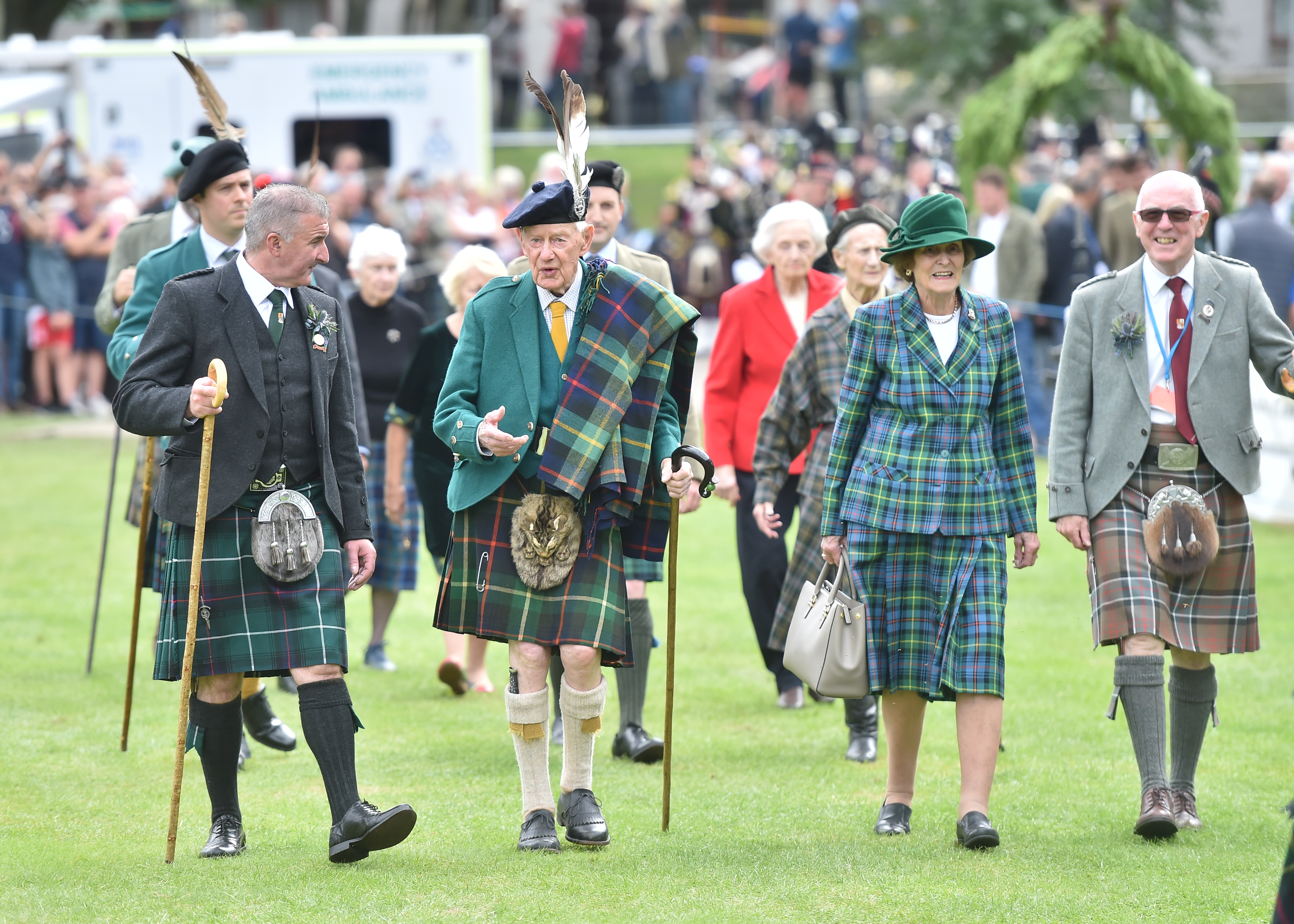 Games chieftain Captain Alwyne Farquharson, second from left, turned 100 this year.