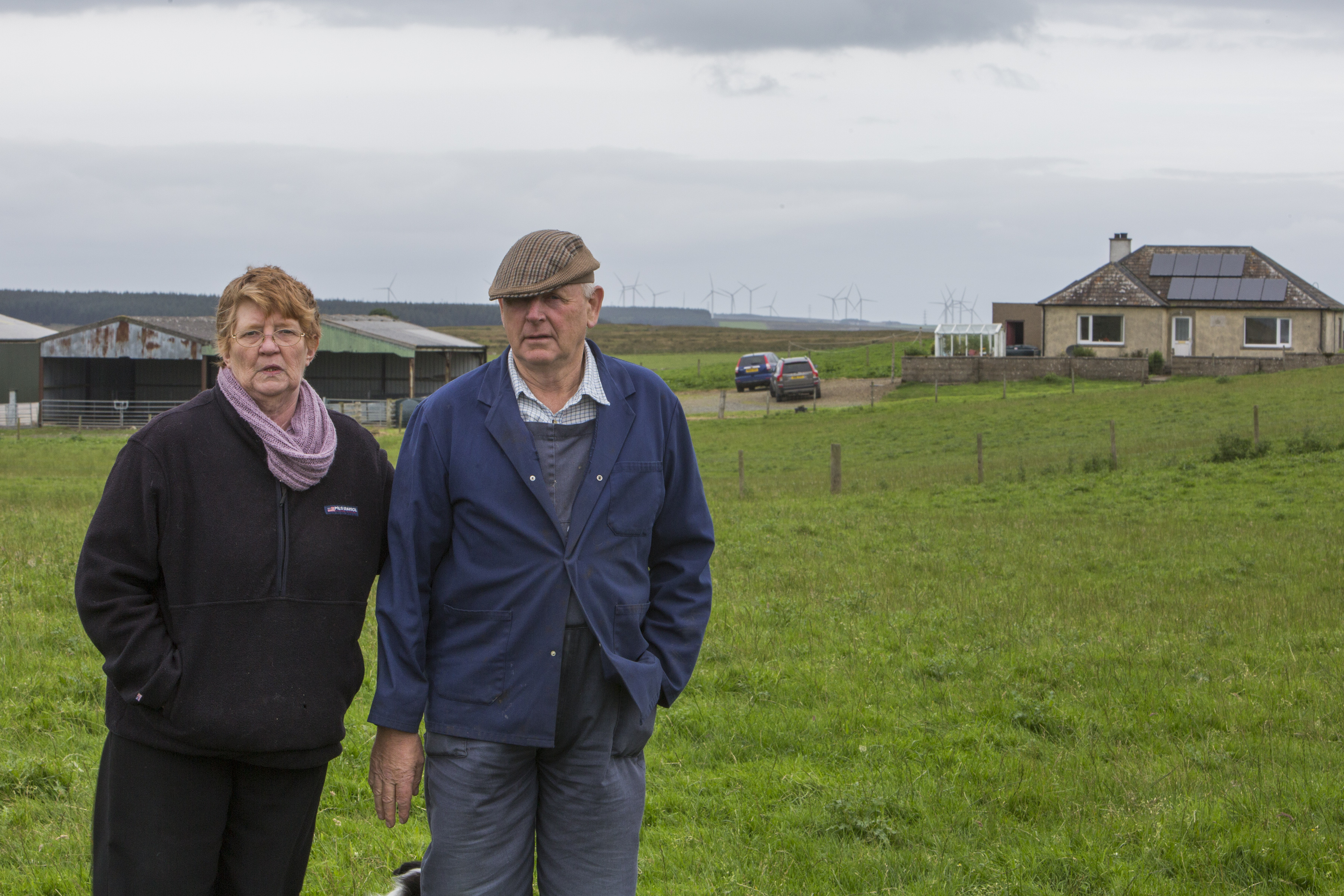 Hamish and Lesley Ritchie outside their home, which is sandwiched between the Ballie and Causewaymire wind farms.