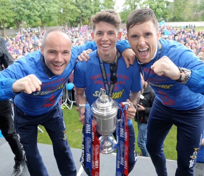 David Raven and Ryan Christie celebrate the Scottish Cup win with Tansey and fans at the Northern Meeting Park in June 2015.