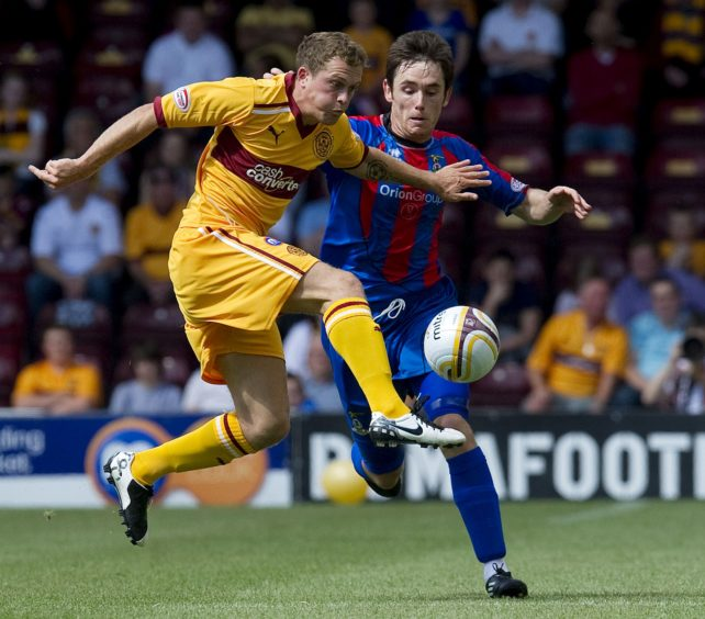 Nicky Law (left) is closed down by Inverness CT's Greg Tansey on his ICT debut in July 2011.