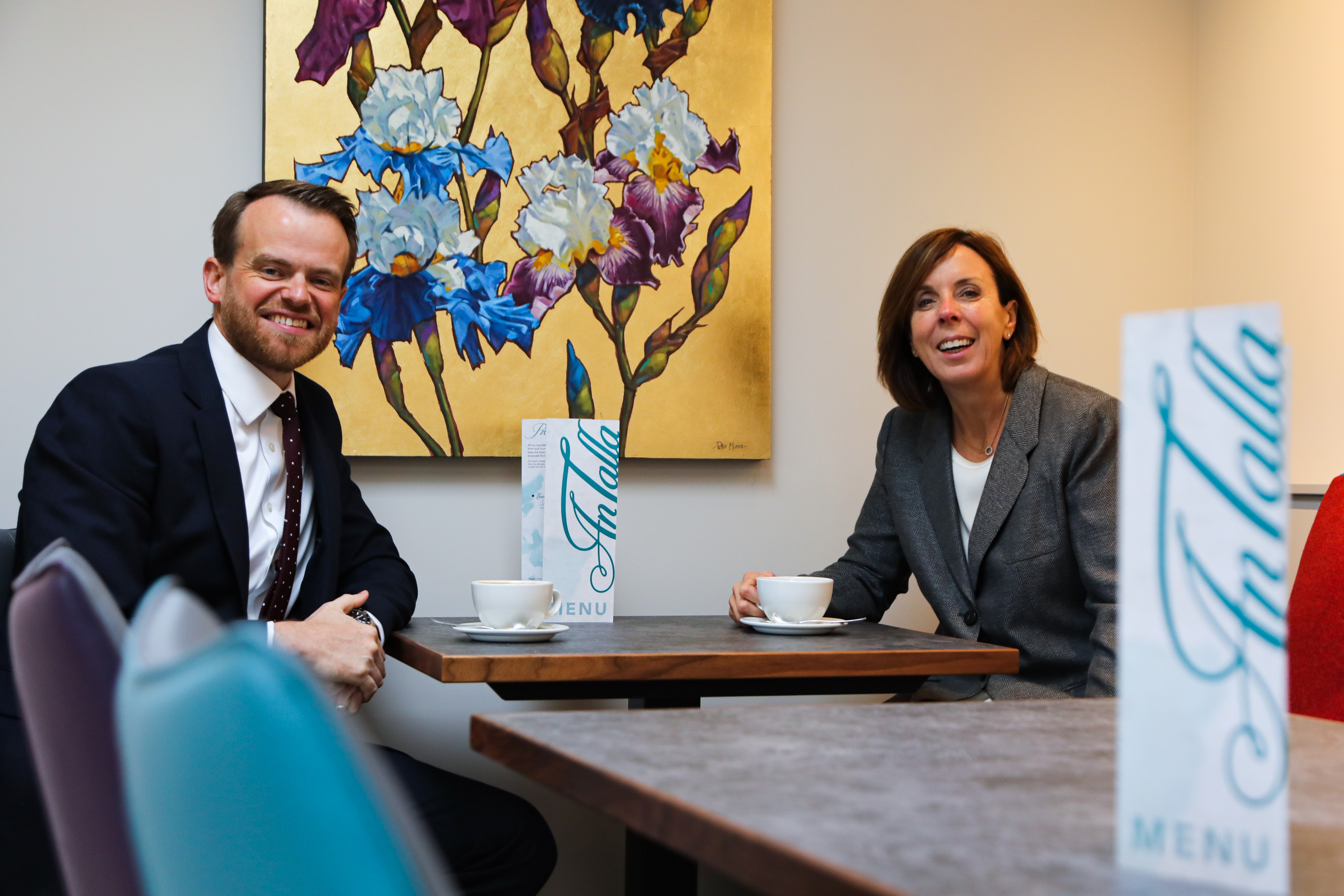 Barrie Aird of the Bank of Scotland and Freda Newton enjoy coffee in An Talla