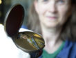 Volunteer and shop manager, Sonja McLachlan shows off the finely enamelled 'Hidden Portrait snuff box which is now on display at Fort William's West Highland Museum . PICTURE IAIN FERGUSON, THE WRITE IMAGE