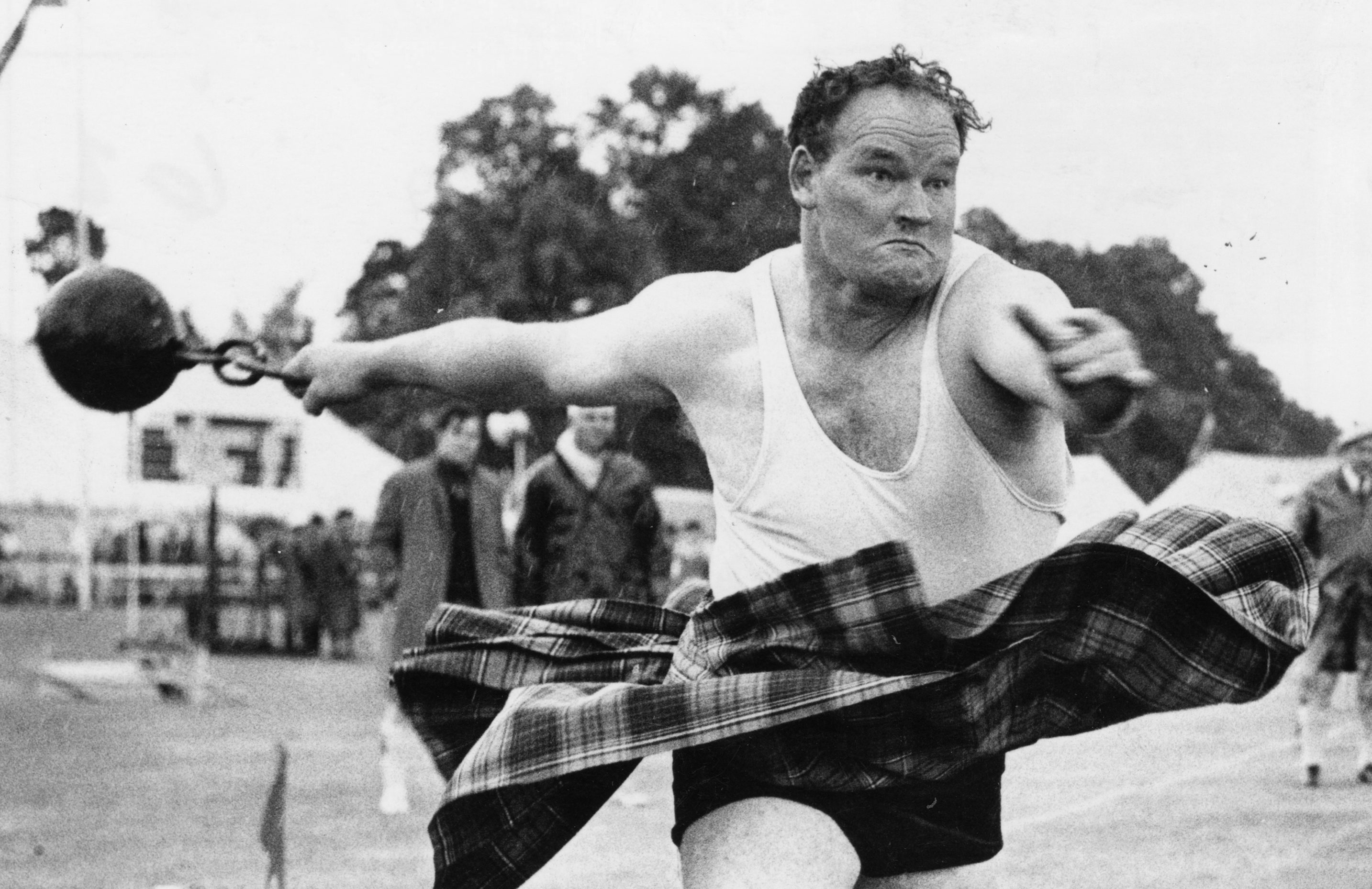 Braemar Gathering 1970-09-02 Bill Anderson (C)AJL Used P&J 03.09.1970 Bill Anderson throws the 56lb. weight by ring to win the event. The picture clearly illustrates the determination and power of Bill's effort.