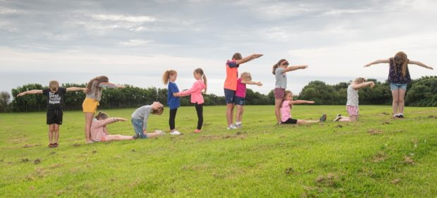Children from the Newtonhill Out of School Club recreate the TechFest sign at The Bettridge Centre.