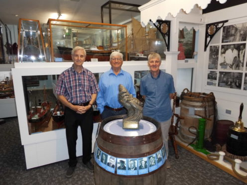 Left to right we are Stan Earl, Bob Dickson and Peter Page of the Port of Lowestoft Research Society with the Prunier Herring Trophy
