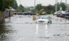 Flooding in Elgin earlier this week. Much of Scotland is braced for more heavy rain over the weekend.