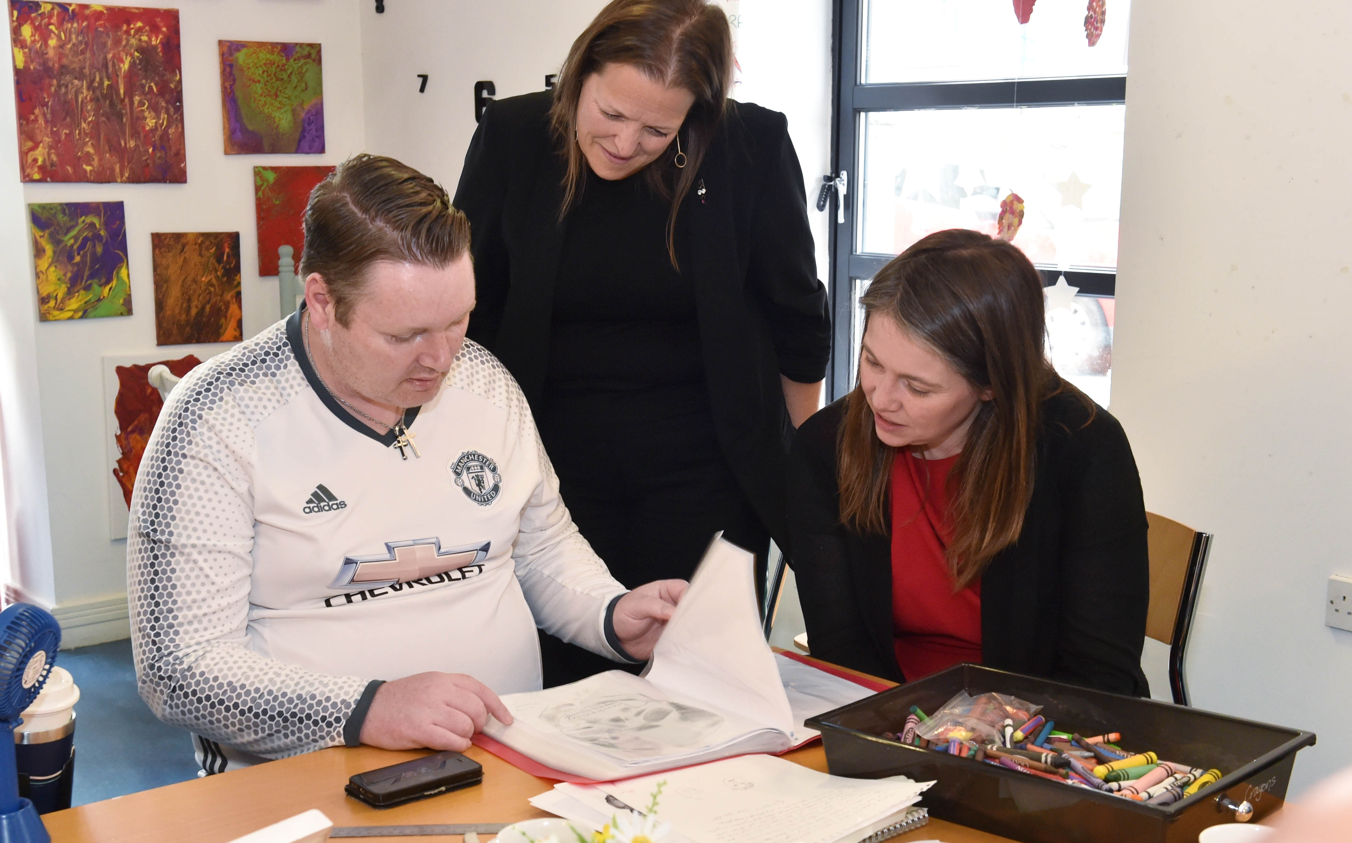 The Cabinet Secretary for Communities Aileen Campbell  (right) visited Aberdeen Foyer. She is speaking to service user Shaun Watt in the art class. Also pictured is Foyer Chief Executive Leona McDermid. Picture by COLIN RENNIE    August 20, 2019