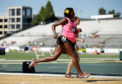 SACRAMENTO, CA - JUNE 26:  A pregnant Alysia Montano runs in the opening round of the women's 800 meter run during day 2 of the USATF Outdoor Championships at Hornet Stadium on June 26, 2014 in Sacramento, California.  (Photo by Ezra Shaw/Getty Images)