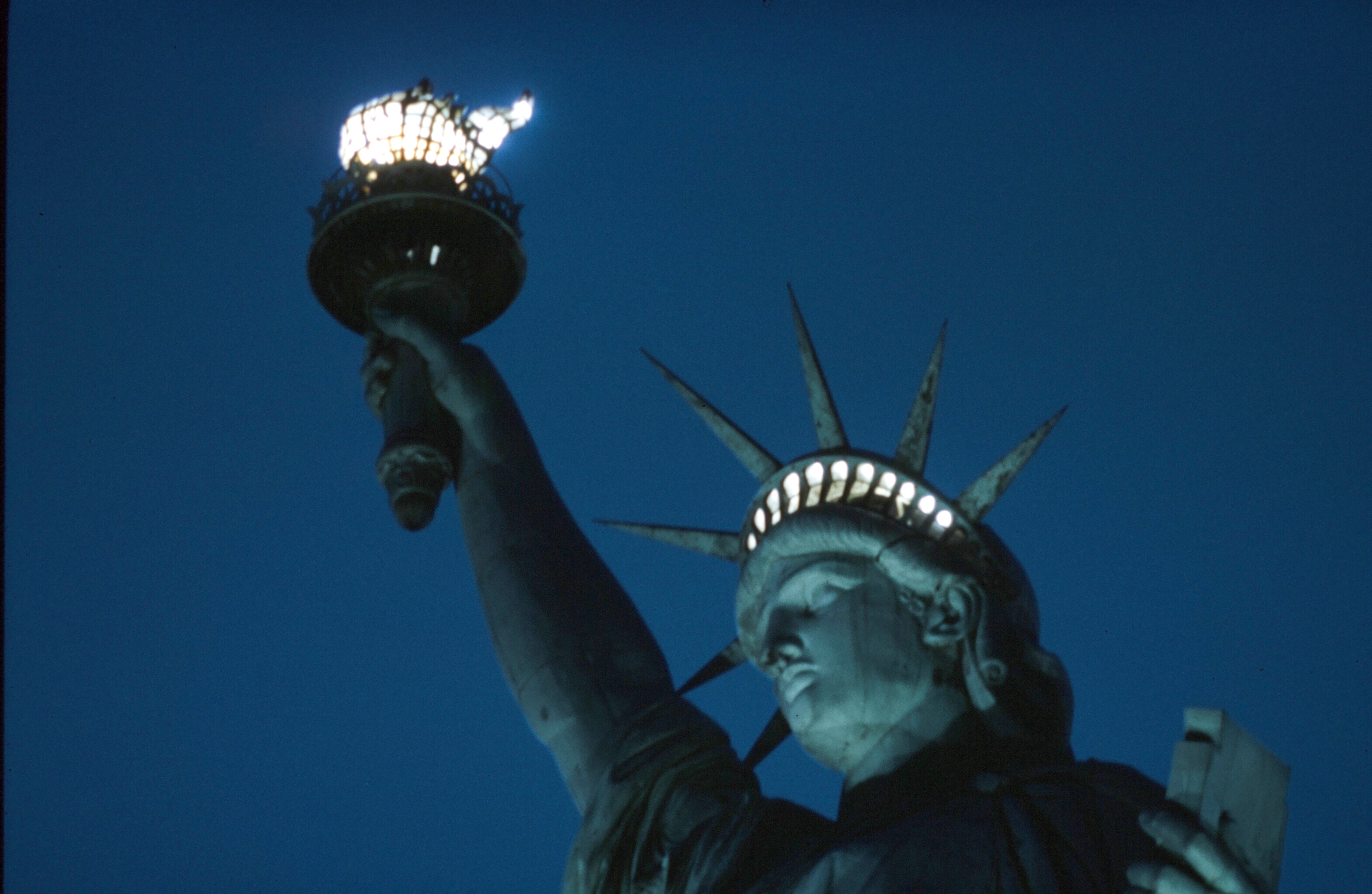 NEW YORK - JANUARY 1942: A view of the Statue of Liberty at night as the torch is lit, on Liberty Island in New York, January 1942. (Photo by Ivan Dmitri/Michael Ochs Archives/Getty Images)