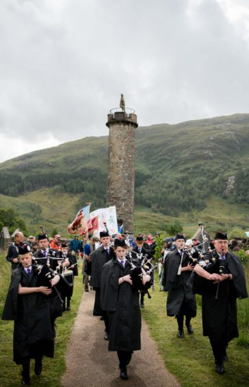 Lochaber pipe band lead the march from monument to games field