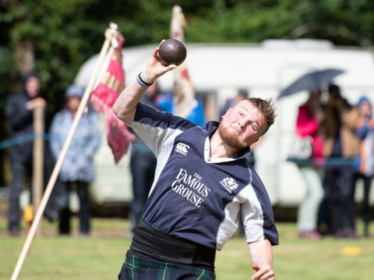 Heavies competitor Alistair Davidson in Shotput action.