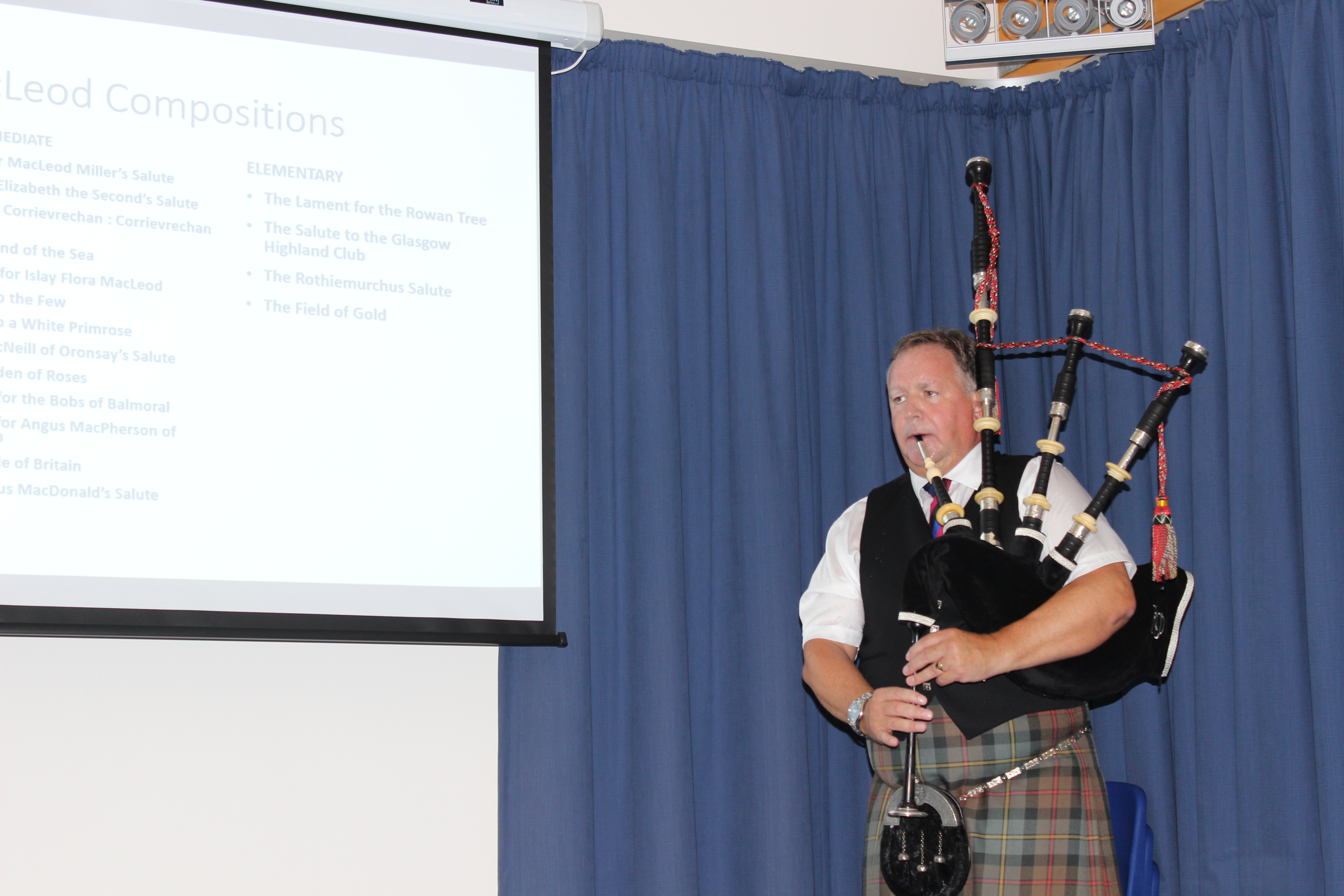Roddy Macleod, director of the National Piping Centre and technical adviser on the book, playing a piobaireachd at the launch
