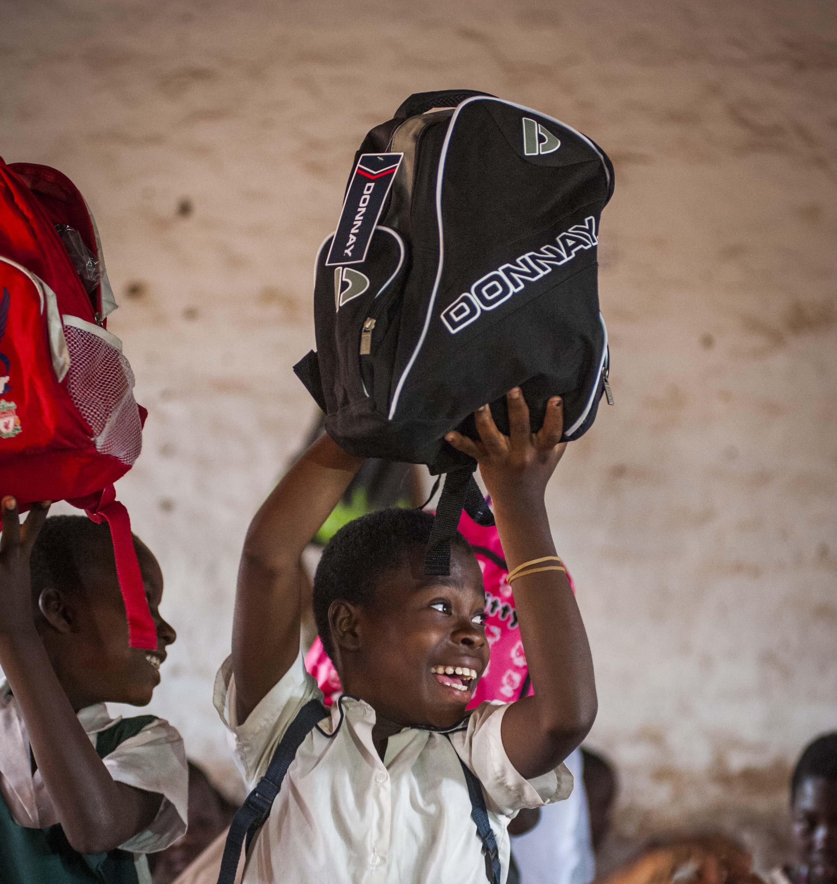 Children in Malawi receiving backpacks