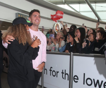 Love Island winners Amber Gill and Greg O'Shea greet fans as they arrive at Stansted Airport in Essex following the final of the reality TV show.