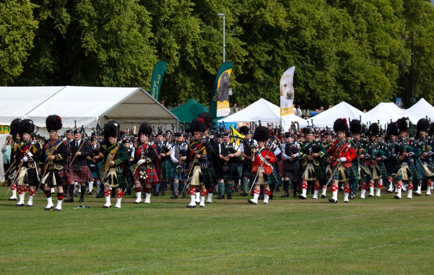 Massed pipe bands at Aboyne Highland Games