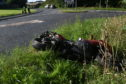 The motorbike at the side of the road following the crash