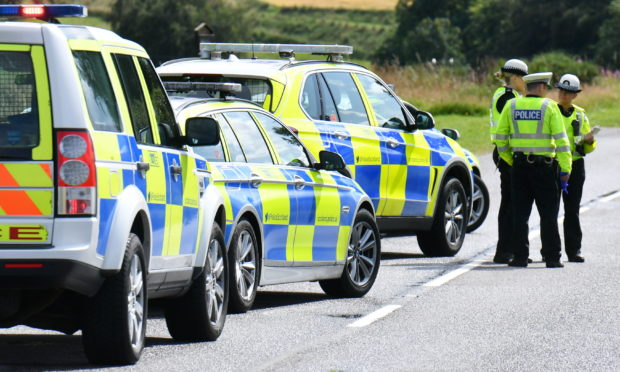 Police at the scene of the collision on the A97 near Kildrummy.