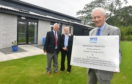 The new renal unit at Kincardine Hospital in Stonehaven was officially opend on Thursday. Pictured is Dr Neil Edward one of the pioneers of renal dialysis at ARI and looking on from left are, Billy Hunter Past President of Rotray Club of Stonehaven andDr Ann Humphrey associate specialist in the ARI's dialysis unit. CR00013256 Pic by Chris Sumner Taken 22/8/19