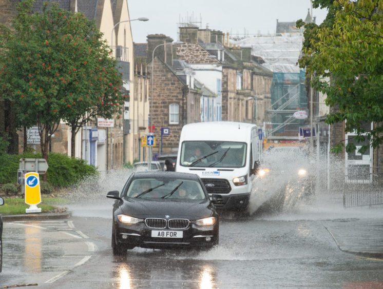 A very quick and heavy downpour of rain in Elgin leaves some flash flooding.