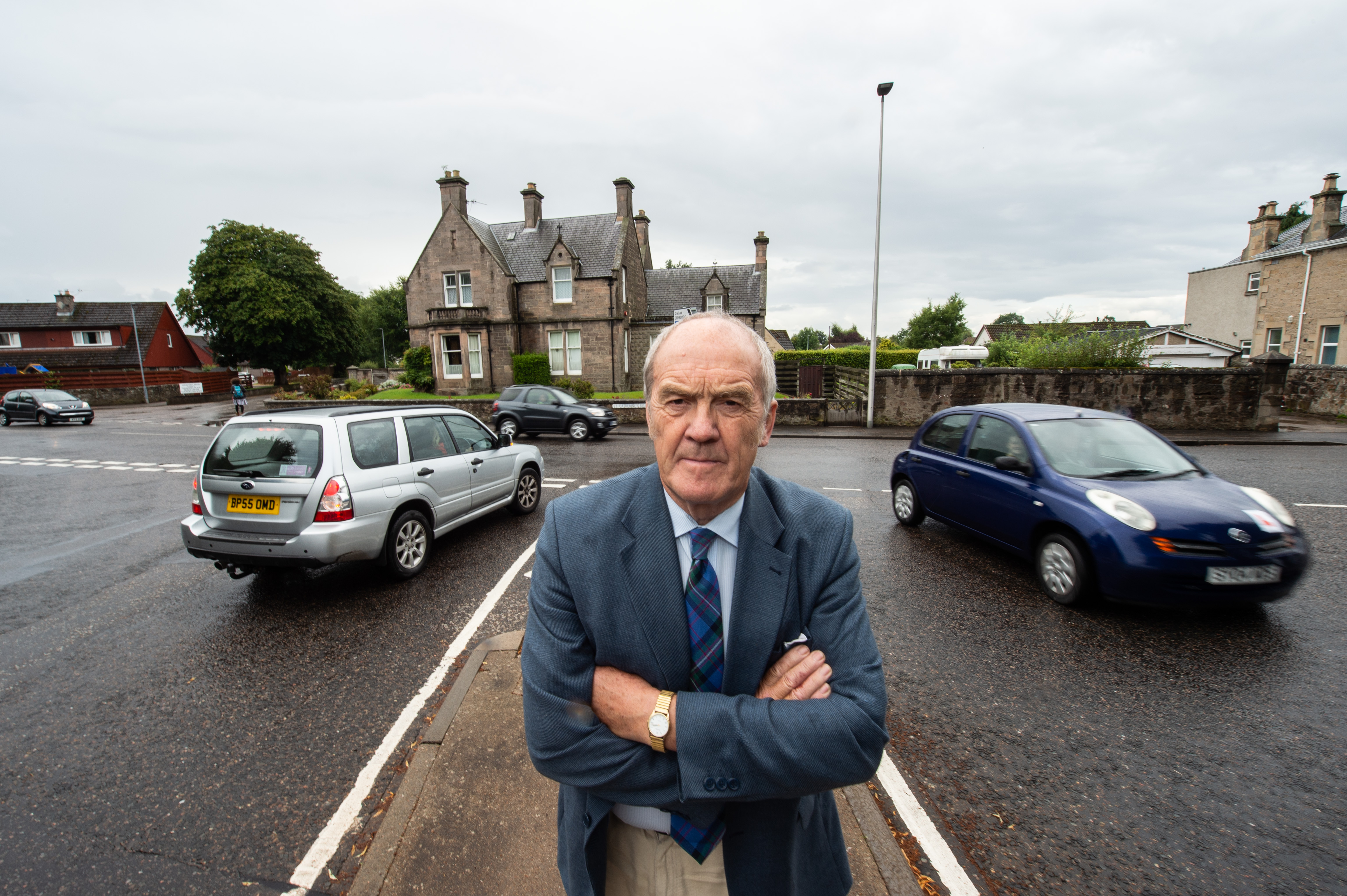 Councillor George Alexander at the junction of Orchard Road and St Catrherine's road in Forres last year