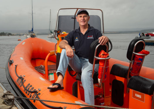 Retired deputy coxswain Donald Watson upon the Lifeboat 'Miro' at Findhorn Harbour