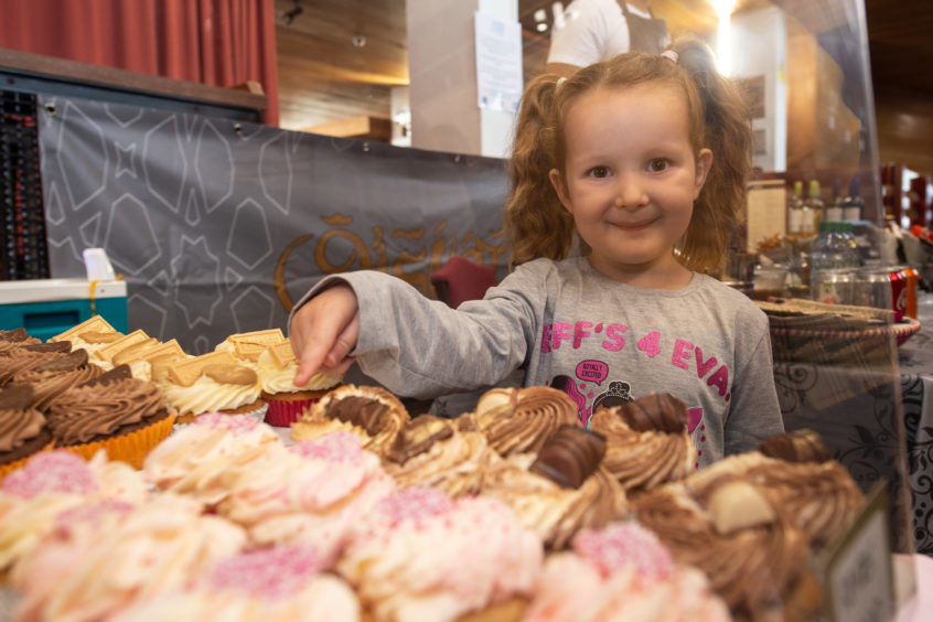 Evie Stewart, five, from Elgin, picks her favourite cake at Elgin Food and Drink Festival 2019