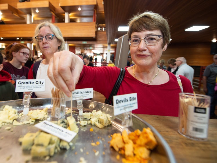 Marianne Davidson tries the produce at Elgin Food and Drink Festival 2019