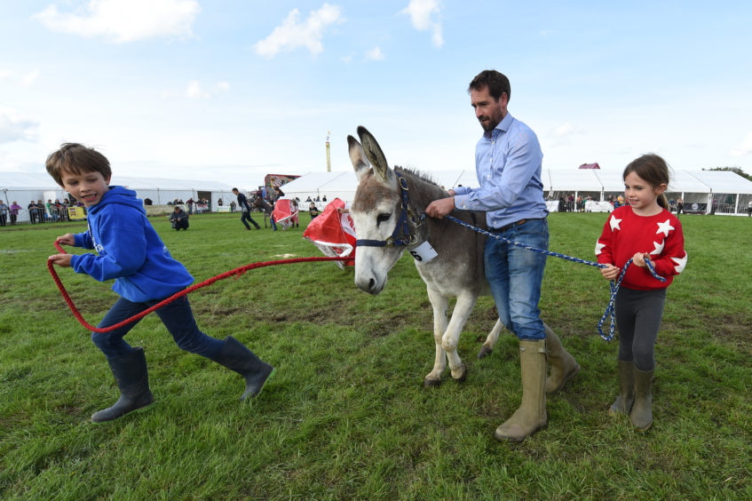 Family Henderson from Archiestown are pictured participating in the donkey derby.