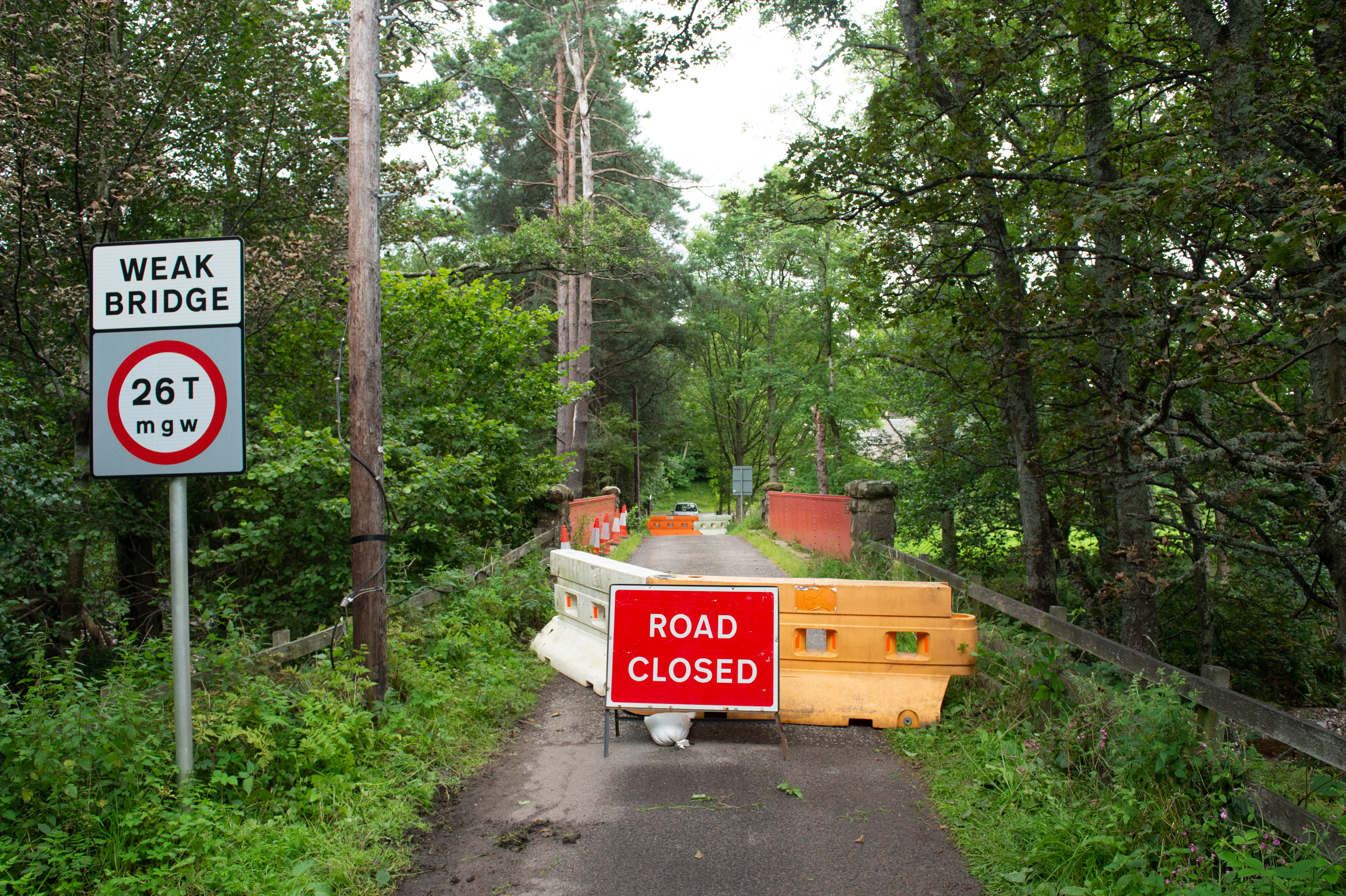 The closure of Delfur bridge at Boat-O-Brig in Moray with sandbags and bridge damage.