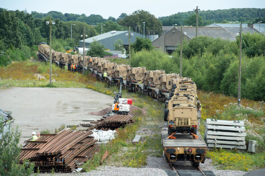 Foxhounds and Landrovers are loaded onto a freight train at Elgin train station, Moray, destined for Salisbury Plain in Wiltshire.