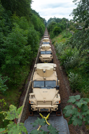 Pictures by JASON HEDGES     Foxhounds and Landrovers are loaded onto a freight train at Elgin train station, Moray, destined for Salisbury Plain in Wiltshire.   Pictures by JASON HEDGES