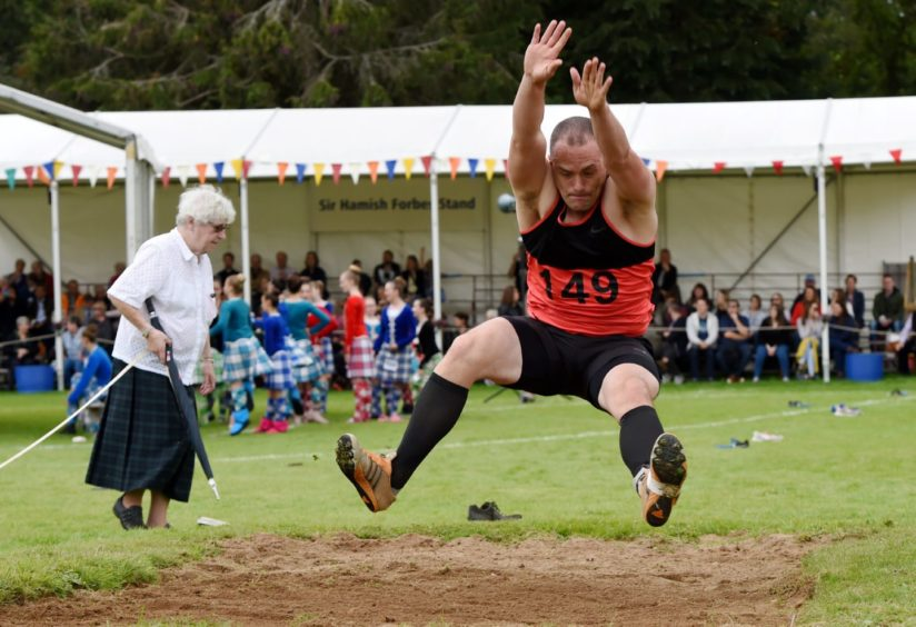 Fraser Davidson during the long jump.  Picture by KENNY ELRICK