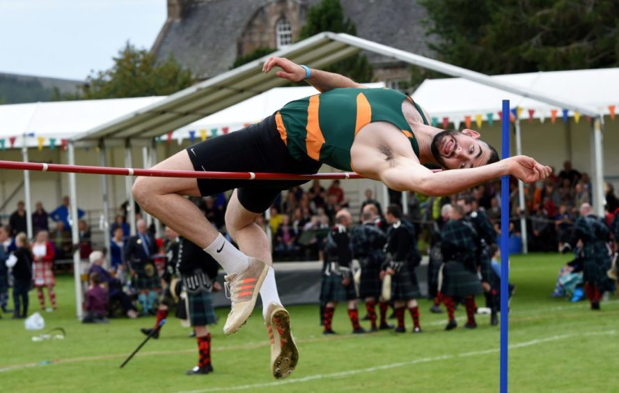 Andrew Murphy doing the High Jump.  Picture by KENNY ELRICK