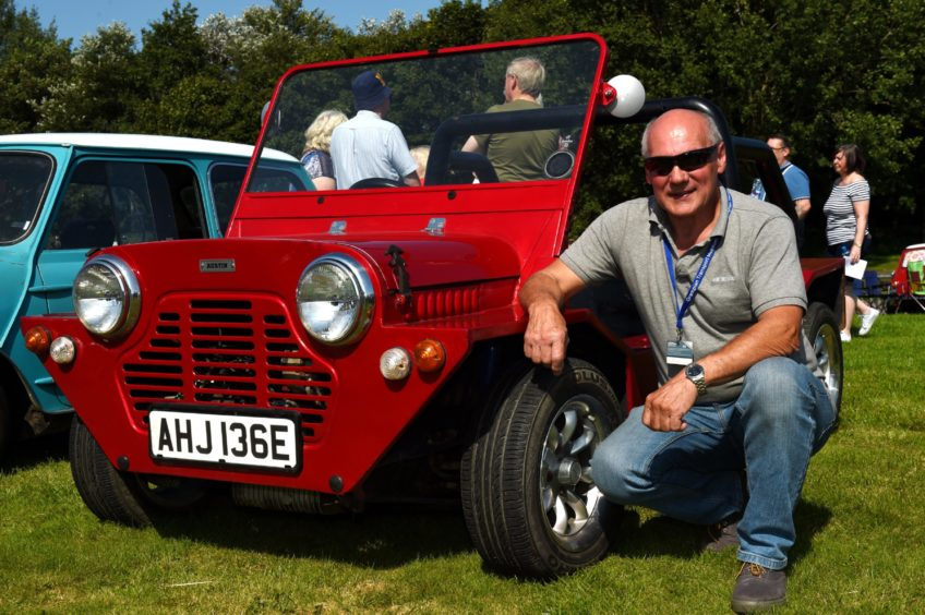 Stuart Walker with his 1967 Mini Moke.  Picture by KENNY ELRICK
