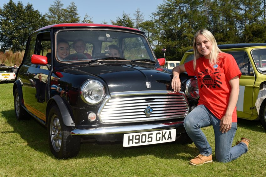 Karleen Arnold with her 1989 Mini checkmate limited edition.  Picture by KENNY ELRICK