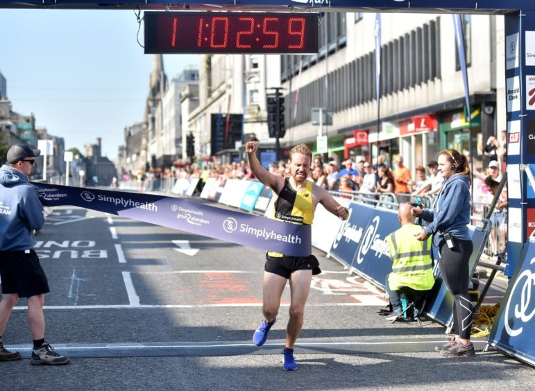 Mens 10K winner - Ben Ward.   Picture by Scott Baxter