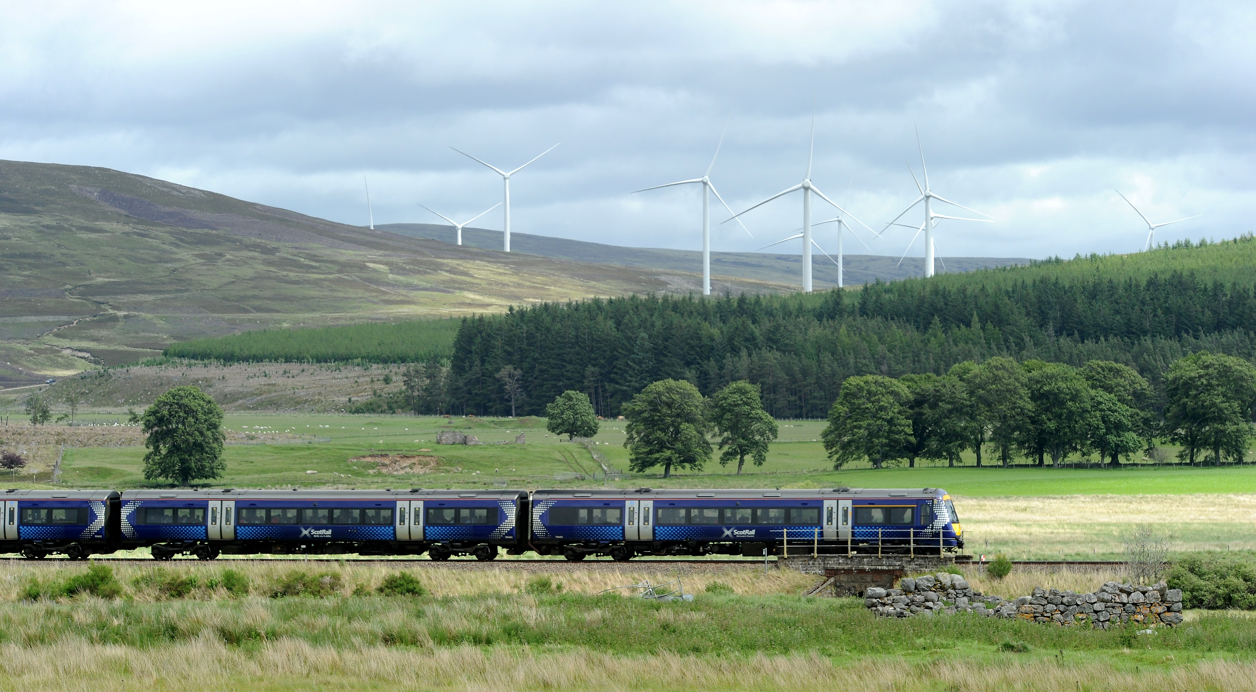 ScotRail train passes the Moy Windfarm as it heads to Perth