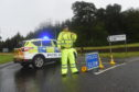 Police closed the road at Fochabers