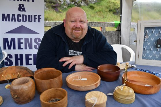 DAVY GAULT, VICE CHAIRMAN OF THE BANFF AND MACDUFF MENS SHED, WITH SOME OF THE ITEMS THE MEMBERS HAVE BEEN PRODUCING.