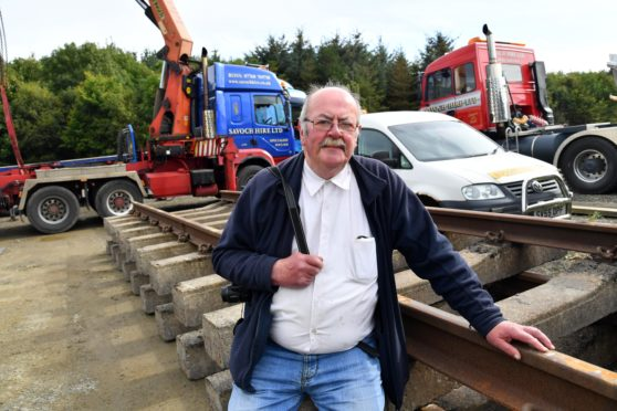 Alan Sangster, a trustee of the Maud Railway Museum, welcomes the arrival of two lengths of railway track.