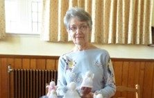 Roseanna Youngson of Banff Parish Church Busy Hands Group with a few of the angels they have knitted
